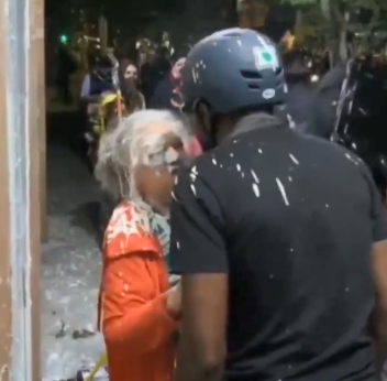Old WOman Doused With Paint